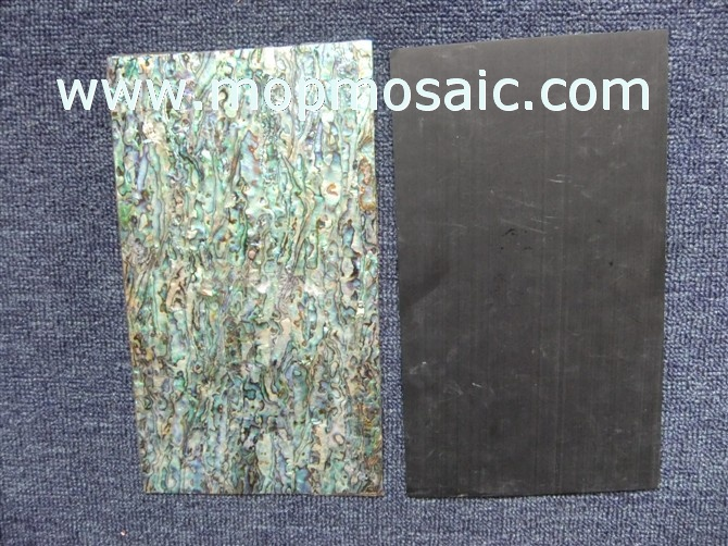 Red abalone shell laminate with black backing